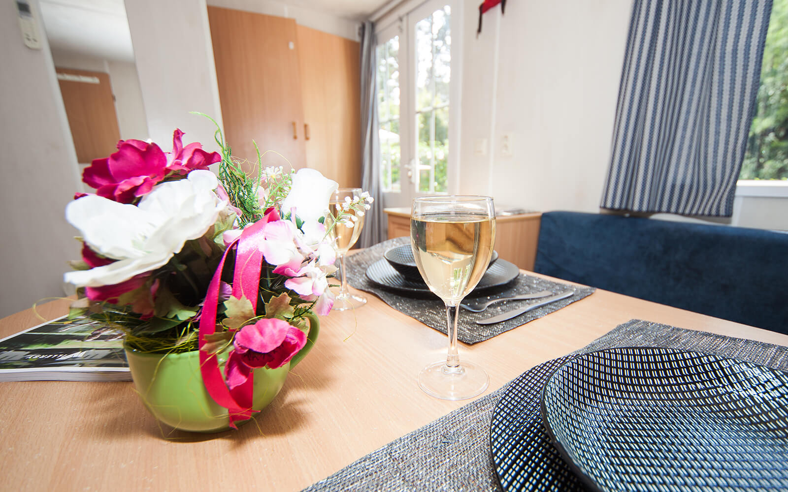 Wine glass on table next to flowers